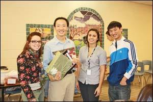 Photo by Terry-Ann Zander; Woo was given Korean cookbooks created by High Point Regional students. Each cookbook contained recipes prepared by students in honor of his visit. From left, Megan Van Glahn, Sung J. Woo, Brittany Anello and Derek Vanalthuis.